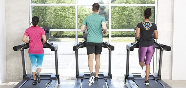 Three people using treadmills.