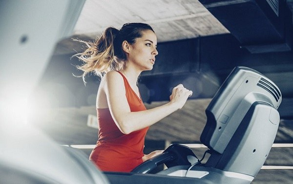 Woman on a treadmill.