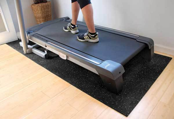 Treadmill on a treadmill mat.