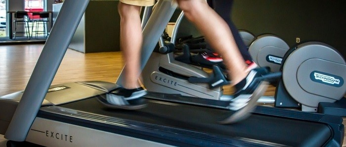 Running on a treadmill.