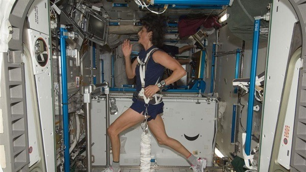 Running on a space station treadmill.