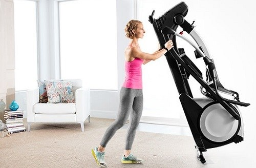 Woman Holding Folding Elliptical