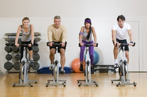 Group Of People Riding An Exercise Bikes