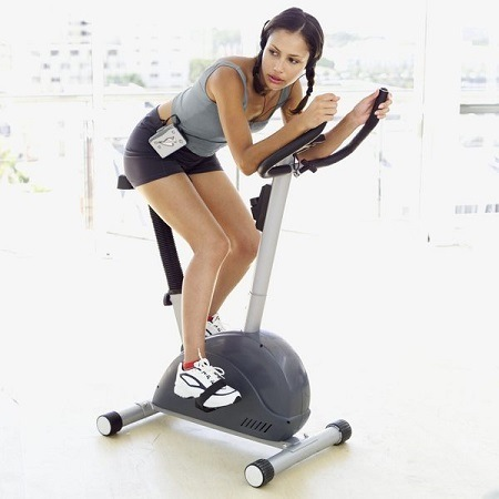 Woman Exercising On Indoor Bike